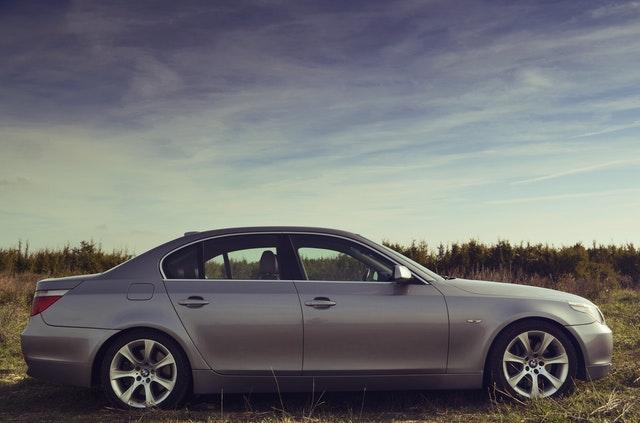 sedan car in silver parked outside