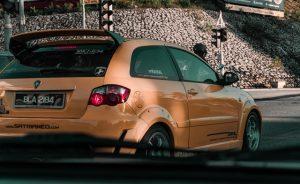 Hatchback car in orange sporty