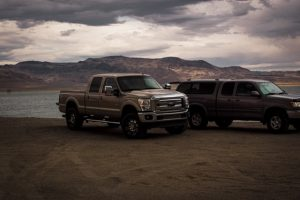 two pick up trucks parked outside